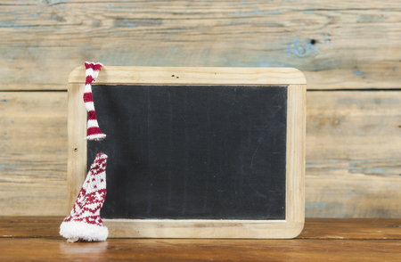 empty chalkboard surrounded of christmas items 스톡 콘텐츠