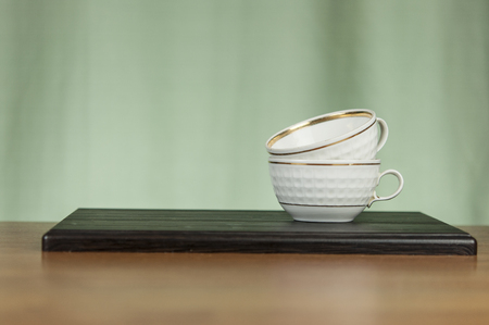 a stack of cups on a wooden table. Copy space