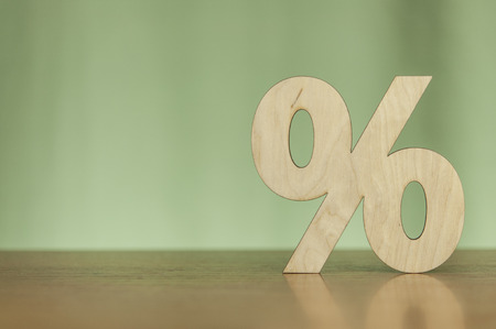Percentage sign symbol icon wooden on wood table