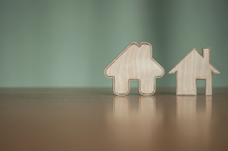 house wood shape on wooden tabletop, copy space
