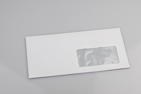 White envelope with address window on gray background Reklamní fotografie