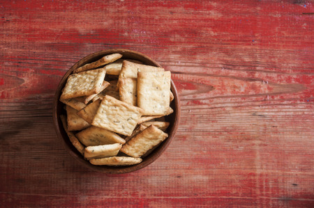 Many small dried rusks bread loaf toast biscuits as texture background. Diet food healthy nutrition