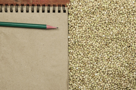 Croup green buckwheat on a dark background. Vegan nutritious and healthy product. Concept of organic food Фото со стока