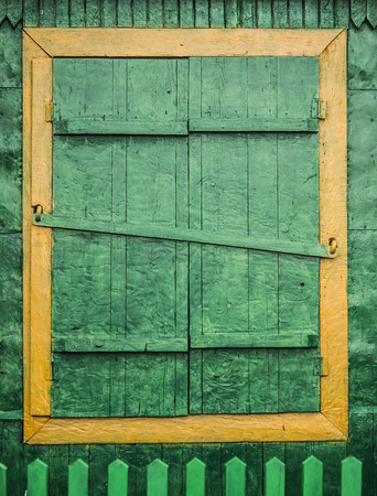 simple old window with shutters on wooden wall Stock Photo - 122828667