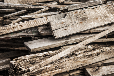 pile of boards after the reconstruction of the building. broken boards with nails. Old boards. Background Imagens