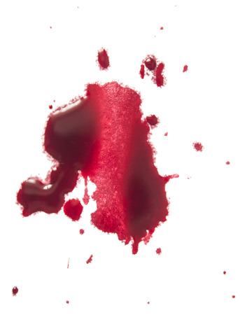 close up of red paint drops on white background
