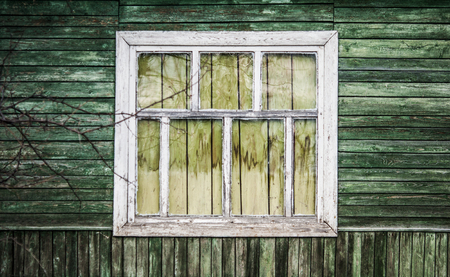 simple old window with shutters on wooden wall Stock Photo