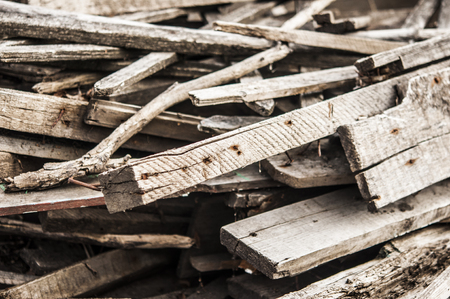pile of boards after the reconstruction of the building. broken boards with nails. Old boards. Background Stockfoto