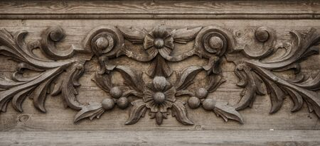 Old wooden decorative carving pattern, background photo texture Фото со стока