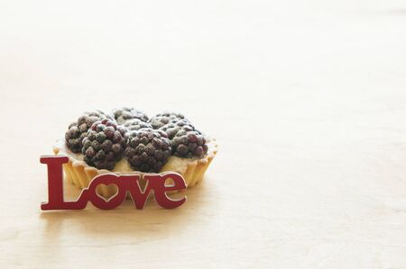 The fruit cupcake with the word love on a white background. Copy space