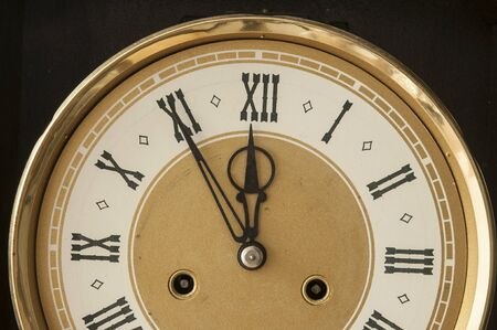 Roman numerals shows for five minutes twelve hours. Holiday New year Stockfoto