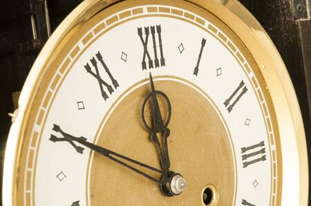 Roman numerals shows for five minutes twelve hours. Holiday New year  Imagens