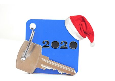 Concept for business, new year, real estate, property, rental, hotel business, building. 2020 happy new year wood number and keys on white Stock Photo