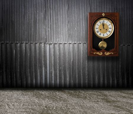 wood wall with a clock showing the time is five minutes to twelve. vintage background