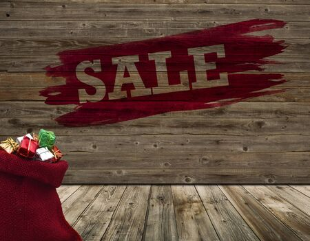 Wide wooden wall with word sale and red sack in old room Zdjęcie Seryjne
