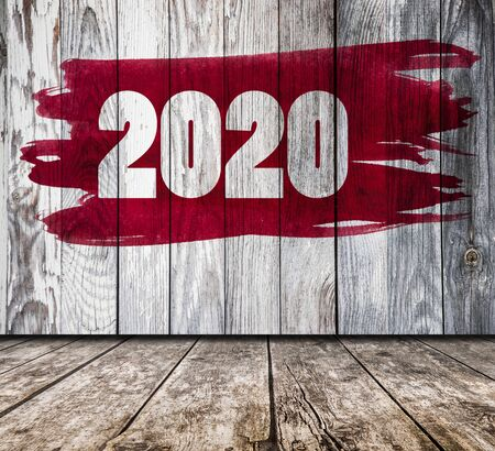 2020 digits on wooden wall in vintage room. Happy new year concept