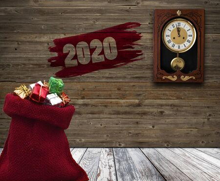 A red small bag with Christmas gift boxes and wood wall with a clock showing the time is five minutes to twelve.