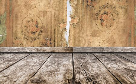 old grunge room, wooden floor, wall background with torn vintage wallpaper. retro background