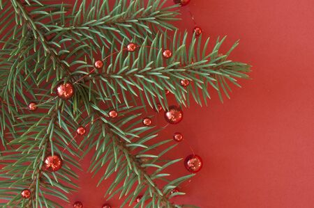 Christmas framework with fir branches and red beads. Flat lay with a copy of the space. The view from the top Stock fotó