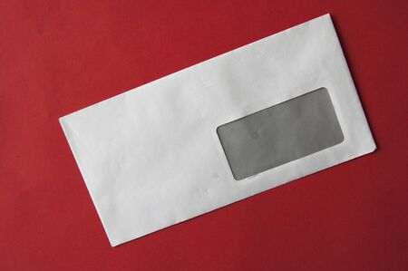 envelopes on red table top view. Mockup for business mail, blogging and office correspondence. Flat lay. Stock fotó