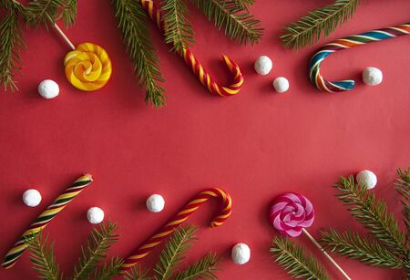 Christmas tree fir background with candy cane. top view