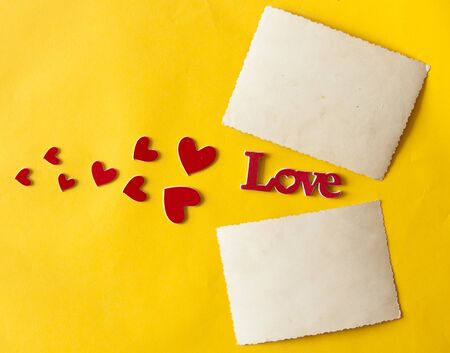 Love word and heart shaped on a yellow paper background.  Top view. Valentines day, mothers day, holiday. Stock fotó