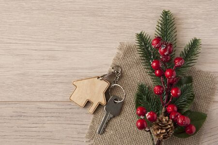Beautiful Christmas background: decorative house and key to the lock. Concept of finance and housing loans. Top view Stock Photo
