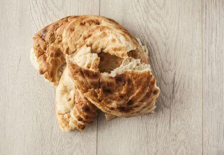 Uzbek flatbread lavash on wooden background