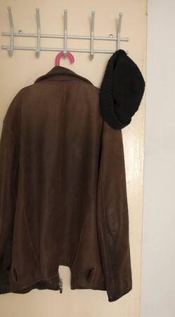 Old fashioned leather jacket on hanger  Zdjęcie Seryjne