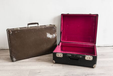 Vintage weathered old classic travel leather suitcases. Travel luggage concept.