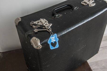 rustic leather vintage suitcases and old two keys with sign home sweet home. welcome home