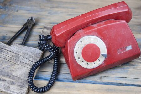 Classic old rotary dial telephone on wood table