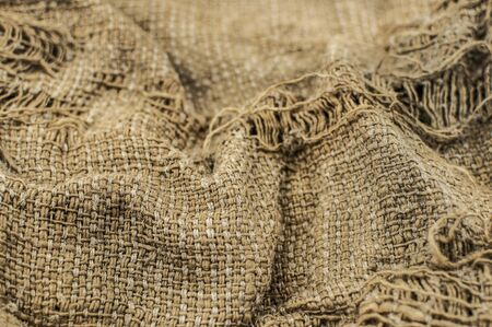 Burlap texture, shaded brown canvas background