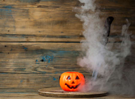 Scary Halloween pumpkin with the smoke. Jack-o-lantern. All Saint's day.