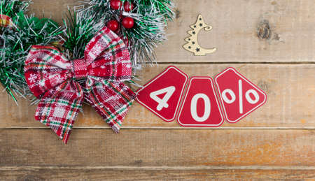 Big sales 40%, forty percents with Christmas wreath on a old barn plank background, top view, copy space. Christmas big sale.