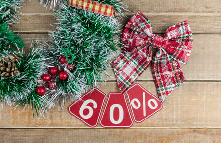 Big sales 60%, sixty percents with Christmas wreath on a old barn plank background, top view, copy space. Christmas big sale.