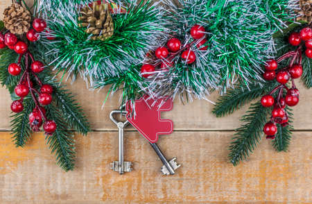 Beautiful Christmas background: decorative house and key to the lock. Concept of finance and housing loans. Top view Imagens