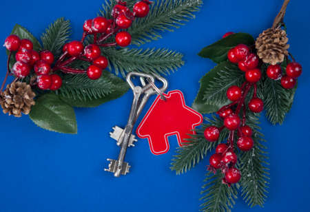 Beautiful Christmas background: decorative house and key to the lock. Concept of finance and housing loans. Top view. Real estate. Stock Photo