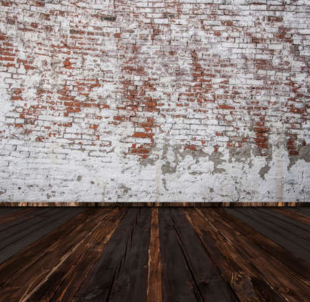 Large empty room - old brick wall with dark floor