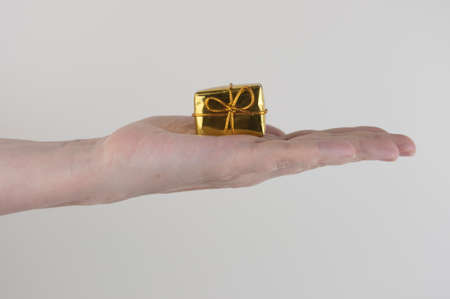 Woman hands holding gift box on white background.