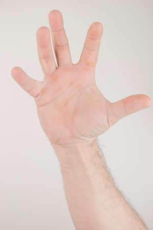 open men hand raised high up on white background