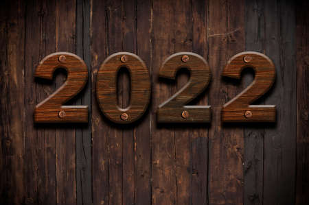 2022 Happy New Year seasonal background with real wood background. Aged parquet of pine wood for flyer, posters or invitations.