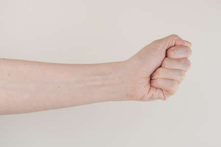 Close up hand and arm on white background. Can use for show your product.