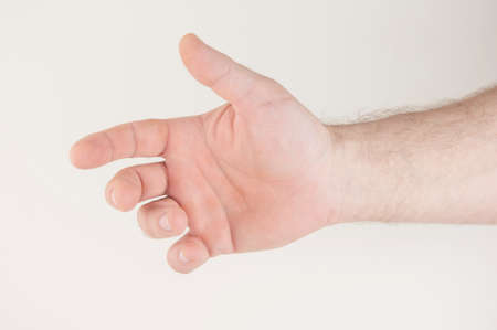 Close up male caucasian hand reach and ready to help or receive. Gesture on white background
