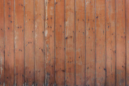 Old vintage wooden wall with color peeling paint for background.