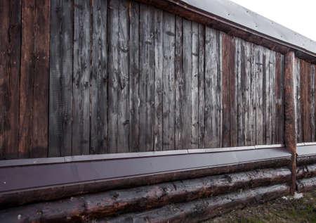 Dark wooden fence background. Old wood.