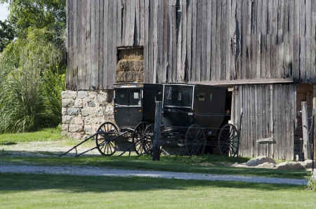 amish buggy: old amish buggy outside a weathered barn
