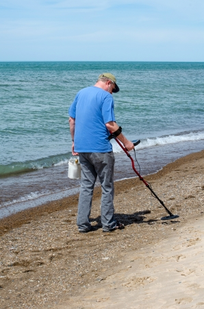 metal detector: man with metal detector