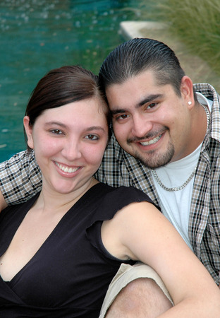 Young hispanic couple smiling in a sunny park, close up photo