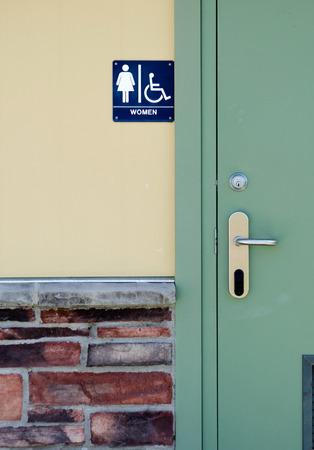 bathroom sign: woman s public bathroom sign in a park